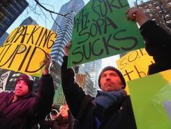 In New York City:  Protesters demonstrate against SOPA and PIPA outside the offices of Sens. Charles Schumer, D-N.Y., and Kirsten Gillibrand, D-N.Y., on Wednesday. Schumer and Gillibrand are co-sponsors of PIPA.