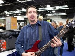 Max Mabley demonstrates the Peavey AT-200 self-tuning guitar, available in September.
