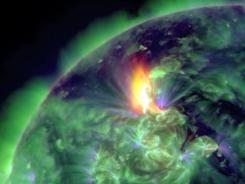 A solar flare is captured by the Solar Dynamics Observatory on Thursday.