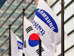 Flags outside Samsung headquarters in Seoul.