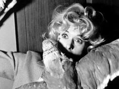 Tippi Hedren is shown in a scene from the 1963 movie The Birds, directed by Alfred Hitchcock.