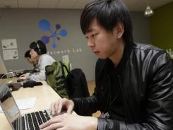 Satoshi Suzuki, president of a social networking startup called Wondershake, works at his office in Tokyo.