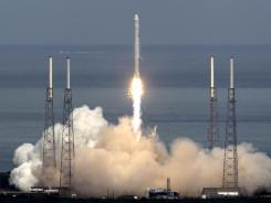 The SpaceX Falcon 9 test rocket lifts off at the Cape Canaveral Air Force Station carrying a mock-up of the company's Dragon spacecraft in June 2010.