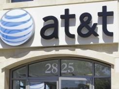 AT&T smartphone customers with unlimited data plans can experience reduced speeds once their monthly usage puts them among heaviest data users.