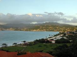 This undated photo shows Grand Anse beach in the foreground and the Caribbean island of Grenada in the distance. Geologists report, that in time, both the Arctic Ocean and Caribbean Sea will be buried because of merging continents.
