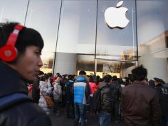 People stand outside an Apple store in Beijing.