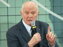 John Glenn, the first American to orbit the Earth, answers questions from the media Friday, three days before the 50th anniversary of his historic flight.