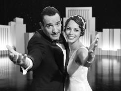 Jean Dujardin portrays George Valentin, left, and Berenice Bejo portrays Peppy Miller in a scene from 'The Artist.'