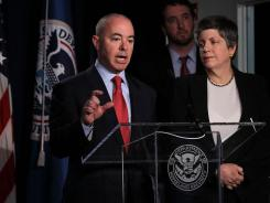 U.S. Citizenship and Immigration Services Director Alejandro Mayorkas at a speaking engagement last year as U.S. Secretary of Homeland Security Janet Napolitano looks on.