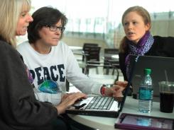 During their lunch hour at the Haworth office furniture headquarters, in Holland, Mich., friends (from left) Michelle Hines, Barb Umlor and Melissa Schrotenboer use their laptops and tablet computers to cruise the Web and use social media.