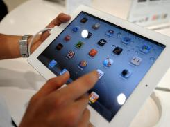 A man navigates through the new iPad 2 during its launch at an Apple store.