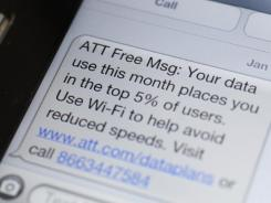 A smartphone showing a text message to an AT&T customer.