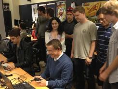 Test drive: Electronic Arts exec Frank Gibeau tries out the video game Tales from the Minus Lab in a USC class.