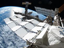 The International Space Station in a July 2011 photo. Thieves stole a laptop containing codes used to control the space station in March 2011.