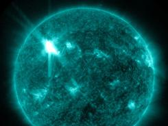An ultraviolet wavelength image provided by NASA shows a solar flare. An impressive solar flare is heading toward Earth and could disrupt power grids, GPS and airplane flights. It is the biggest in five years and growing.