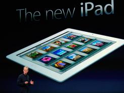 Apple CEO Tim Cook unveils the new iPad in San Francisco on Wednesday.