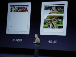 Apple executive Phil Schiller talks about the new iPad, right, versus the iPad2 during Apple's event in San Francisco.