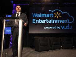 John Aden, a Walmart executive, announces the company's new disc-to-digital initiative.