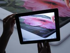 Apple's new iPad has an improved screen and an improved camera.