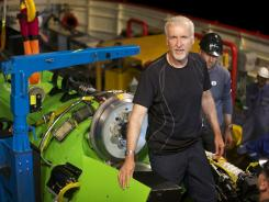 Explorer and filmmaker James Cameron emerging from the hatch of the Deepsea Challenger.