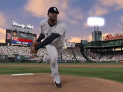 New York Yankees ace C.C. Sabathia is shown pitching in Boston's Fenway Park.