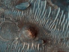 This image taken by the Mars Reconnaissance Orbiter shows an area located west of the Nili Fossae trough on Mars.