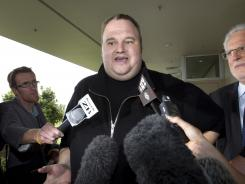 Kim Dotcom, the founder of the file-sharing website Megaupload, speaks to reporters after he was granted bail and released in Auckland, New Zealand.