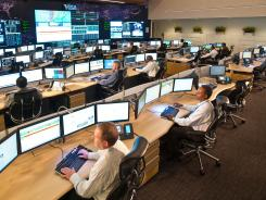 Employees work in the Command Center for Visa's Operations Center East, where global payment transaction volume is analyzed.