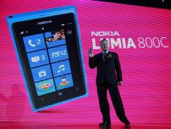 Nokia CEO Stephen Elop announces the launch of the company's new Lumia 800C smartphone in Beijing.