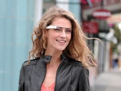 A women models an early prototype of Google's augmented-reality glasses.