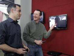 Netflix executives John Ciancutti, left, and Neil Hunt talk at the Netflix headquarters in Los Gatos, Calif.