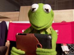 Kermit the Frog checks his iPhone during a taping of 'Talking Your Tech.'