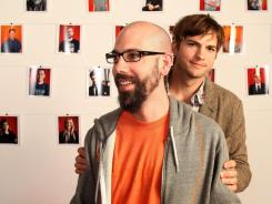 Dwolla founder and CEO Ben Milne, left, and Ashton Kutcher clown around in the offices of Dwolla in Des Moines.