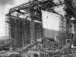 The bows of Olympic, foreground, and Titanic take shape under construction scaffolding in the Belfast shipyard sometime between 1909 and 1911.