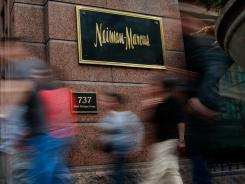 Pedestrians walk past a Neiman Marcus store in Chicago.
