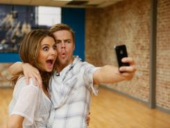 Maria Menounos, the co-host of the syndicated 'Extra,' and her dance partner Derek Hough from 'Dancing with the Stars.' The duo use the iPhone to record and memorize their dance routines.