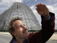 Kaggle president and chief scientist Jeremy Howard shields his eyes in front of a NASA hanger in Mountain View, Calif.