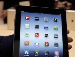 A reporter holds an iPad.