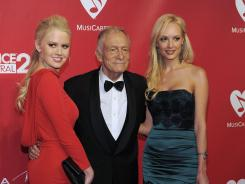 Hugh Hefner, center, Anna Sophia Berglund, left, and Shera Bechard.