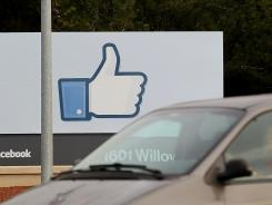 A sign with the 'like' symbol in front of the Facebook headquarters in Menlo Park, Calif.