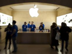 Workers and shoppers at the Apple store in Grand Central Station in New York.