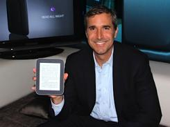 Barnes & Noble CEO William Lynch with the Nook Simple Touch with GlowLight.