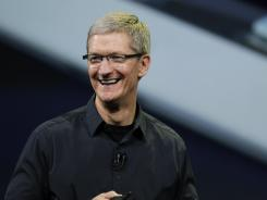 Apple CEO Tim Cook announces the new iPad in San Francisco.