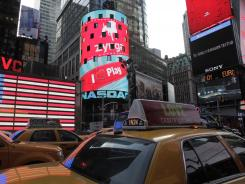 The corporate logo for Zynga, center, is shown on a billboard at the Nasdaq, in New York.