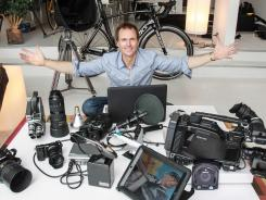 Phil Keoghan, host of CBS's 'The Amazing Race,' surrounded by his gear.