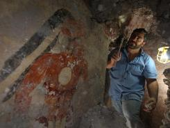 Archaeologist William Saturno of Boston University excavates a house in the ruins of the Maya city of Xultun.