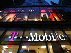 A T-Mobile retail store is shown in Times Square in New York.