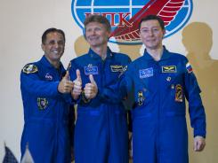 Quarantined Expedition 31 prime crew members, from left, NASA Flight Engineer Joe Acaba, Russian Soyuz Commander Gennady Padalka, and Russian Flight Engineer Sergei Revin pose for a group photograph during a prelaunch press conference held at the Cosmonaut Hotel on Monday, May 14, 2012 in Baikonur, Kazakhstan.