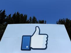 "A thumbs up or ""Like"" icon at the Facebook main campus in Menlo Park, Calif."