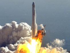 SpaceX and NASA launch a demonstration flight of the Falcon 9 rocket and Dragon spacecraft from Cape Canaveral Air Force Station in Florida on Dec. 8, 2010.